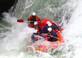 The tour participants have fun in a water vortex during the rotorua rafting waterfall experience - winter with River Rats Rotorua Raft & Kayak.