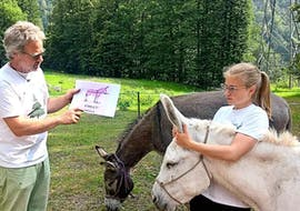 Mario tells a little girl everything about Donkeys during the Canyoning in the Sorba with BBQ&Donkey Activity with Monterosa Canyoning.