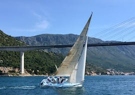 A race sailing boat navigates in Dubrovnik & Elaphiti Islands with The Day Sail Croatia.