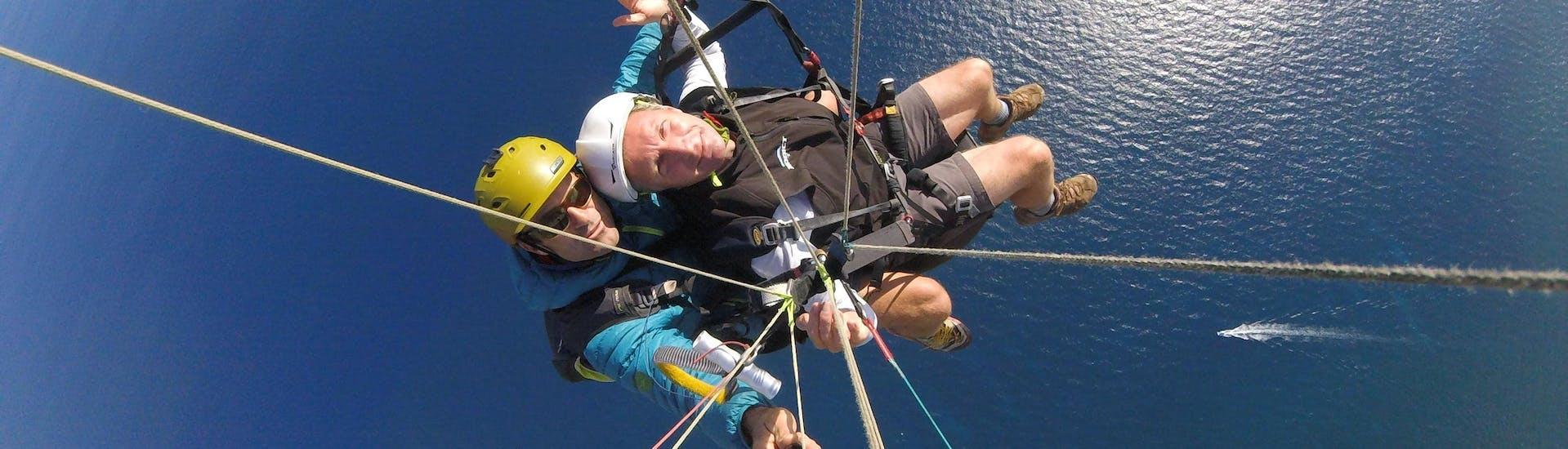 A paragliding pilot from Saint Leu Parapente is performing a Tandem Paragliding Flight over the Baie de Saint Leu in La Réunion.