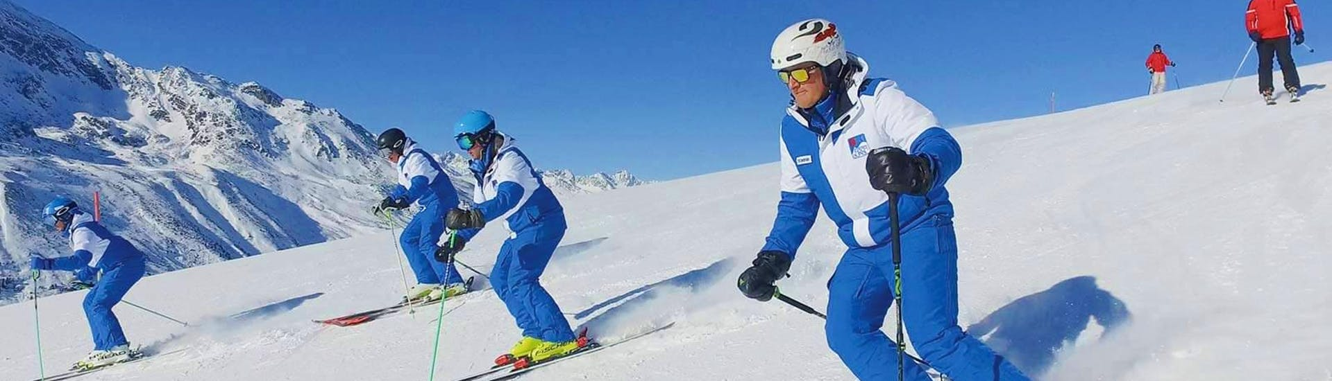 The ski instructors of Schischule Hochgurgl are enjoying the slopes of the Obergurgl-Hochgurgl ski resort where they offer ski and snowboarding lessons to their guests.