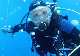 "A diver is underwater for his Scuba Diving Course ""PADI Scuba Diver"" in Saint-Tropez  with European Diving School."