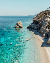 An image of the crystal clear waters along the coast that attract many tourists to come scuba diving on Elba.