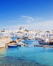 An image of the picturesque harbour from which many boats depart to take people scuba diving on Paros.