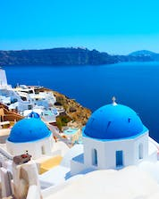 A view from Oia on to the deep blue waters of the Aegean Sea that invite visitors from all over to go scuba diving in Santorini.