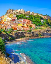 An image of Castelsardo town, surrounded by the clear blue waters of the Mediterranean that are so popular with people who go scuba diving in Sardinia.