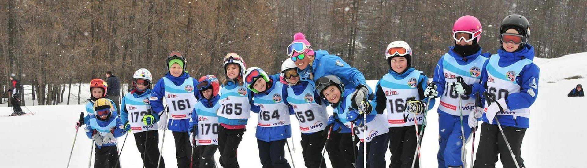 Happy skiers after the ski lessons from the ski school Scuola di Sci Bardonecchia in the ski resort Bardonecchia.