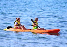 Two girls go on a sea kayak in Ammoudara Bay with H2O Water Sports Heraklion.