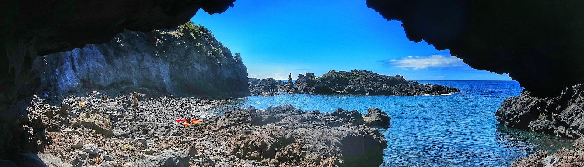 View on a rocky beach from a cave during the Sea Kayaking along the Coast in Caloura with Fun Activities Azores Adventures.
