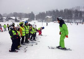 Skiing with the Instructor during Ski Instructor Private Lessons for Kids