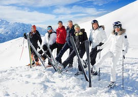 "adults are raising their skier in the Ski Lessons ""All-in-One"" for Adults - Beginner"