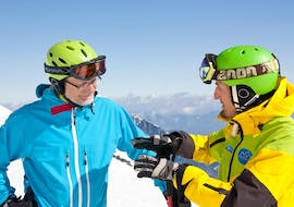 close-up view of ski instructor and adult