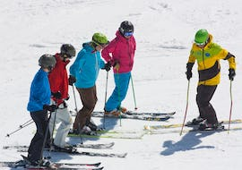 Ski instructor in front of his ski group