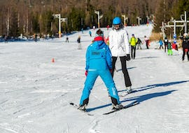 During the Ski Instructor Private for Adults - All Levels, an adult is taking the first steps on ski with the help of an experienced ski instructor from the ski school Ternavski Snow Academy Tatranska Lomnica.