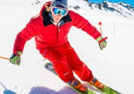 Under the supervision of an instructor from the ski school ESF Ski School Val d'Isère, a skier is enjoying parallel skiing in the Ski Lessons for Adults - All Levels.