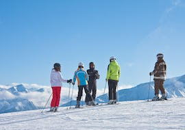 Under the supervision of an experienced ski instructor from the ski school Evolution 2 Val d'Isère, adult skiers are taking their first steps on skis during the Ski Lessons for Adults - All Levels.