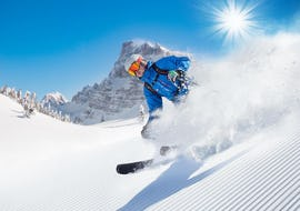 A skier is skiing down a snowy slope during hisSki Lessons for Adults - All Levels with the ski school Prosneige Méribel.
