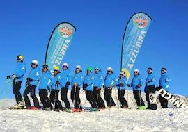 A group of skiers prepare for the Ski lessons for adults - All levels of the ski school Scuola di Sci Azzurra Livigno.