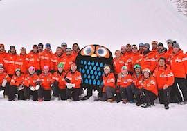 The Ski Lessons for Adults - All Levels is being cheered up by Tino il Civettino, the mascot of the Ski School  Scuola Italiana di sci Civetta.