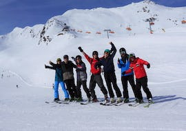 A ski instructor and some participants of the Ski Lessons for Adults - All Levels smiling at the camera, during the ski lessons organized by the ski school Ski & Snowboardschool Vacancia in the ski resort of Sölden.