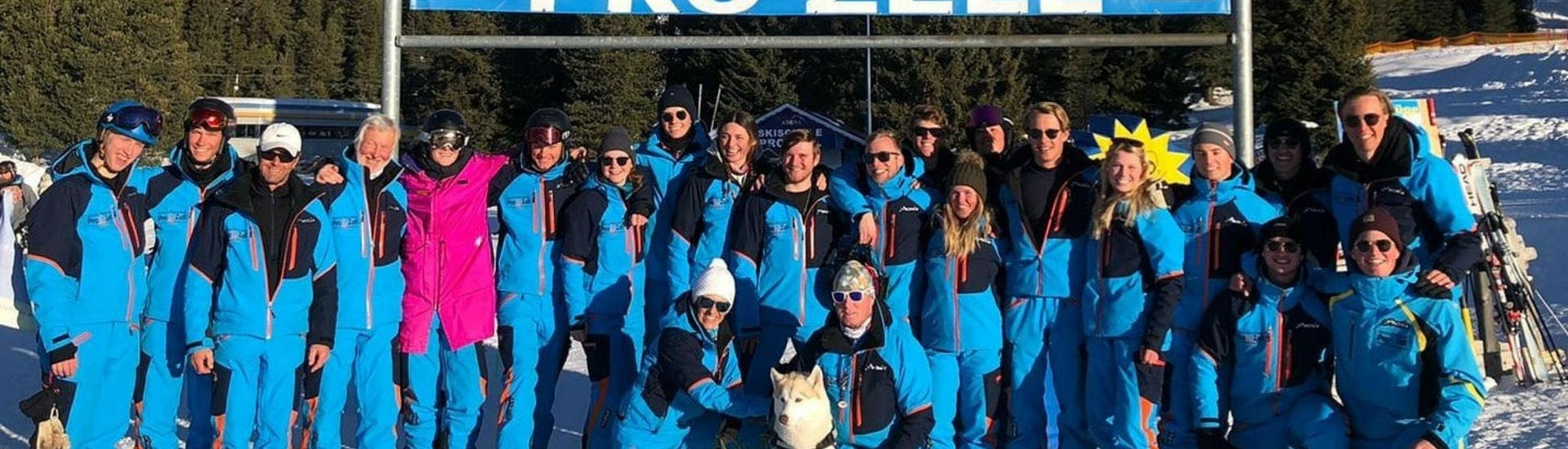 The ski instructors from the ski school Skischule Pro Zell in Zell am Ziller are posing together for a group photo to promote their Ski Lessons for Adults - Beginners.