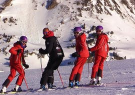 Three skiers and one ski instructor from Escuela Ski Cerler turn towards the camera for the photo during the Ski Lessons for Adults for all Levels.