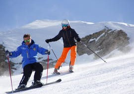 A skier is learning how to descent the slopes of the Via Lattea ski area in Sestriere during a Ski Lessons for Adults - Holidays - Beginner organized by the ski school Scuola di Sci Olimpionica.