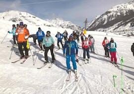 "A group of skiers prepare for the  Ski Lessons for Adults ""Low Season"" - All Levels of the ski school Scuola di Sci e Snowboard Livigno Italy."
