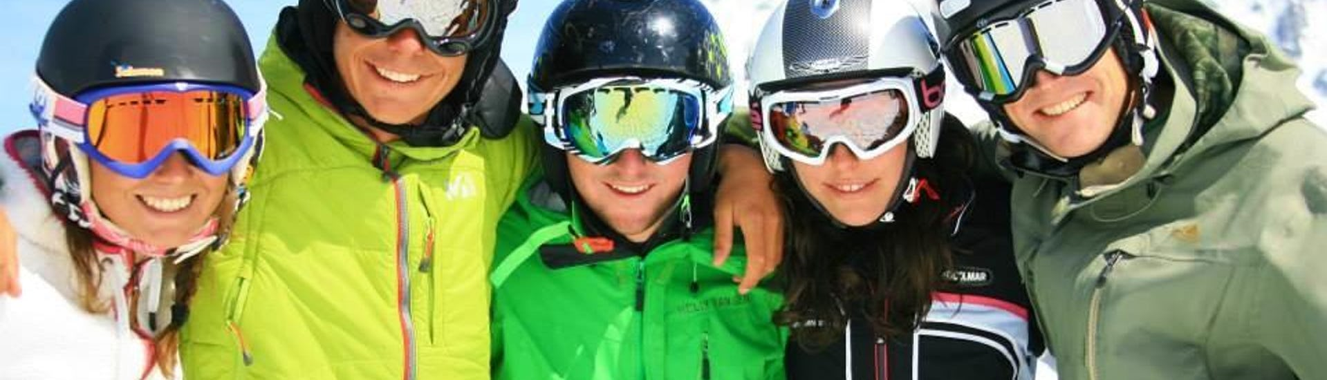 Skiers are smiling at the camera while posing for a picture during their Ski Lessons for Adults + Skipass with the ski school Prosneige Les Menuires.