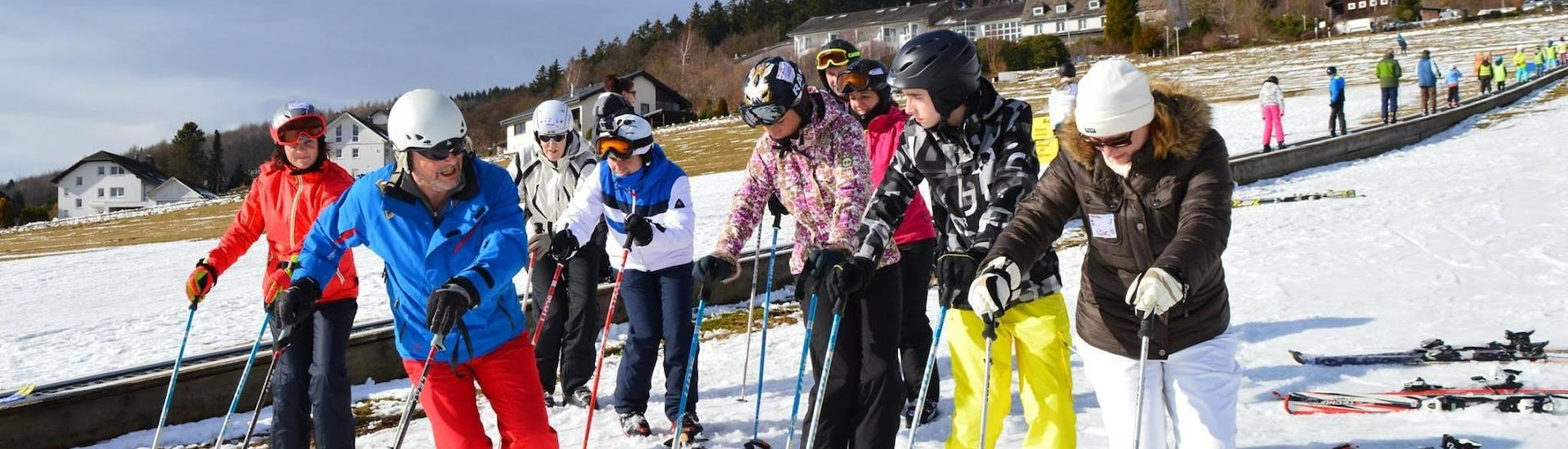 A ski instructor from WIWA   DSV Skischule & Skiverleih is teaching adults the basics of skiing during the Ski Lessons for Teens & Adults - All Levels.