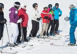 Skiers on the slope with their instructor from the ski school Ski Cool Val Thorens during Ski Lessons for Teens & Adults - Afternoon - Beginners.
