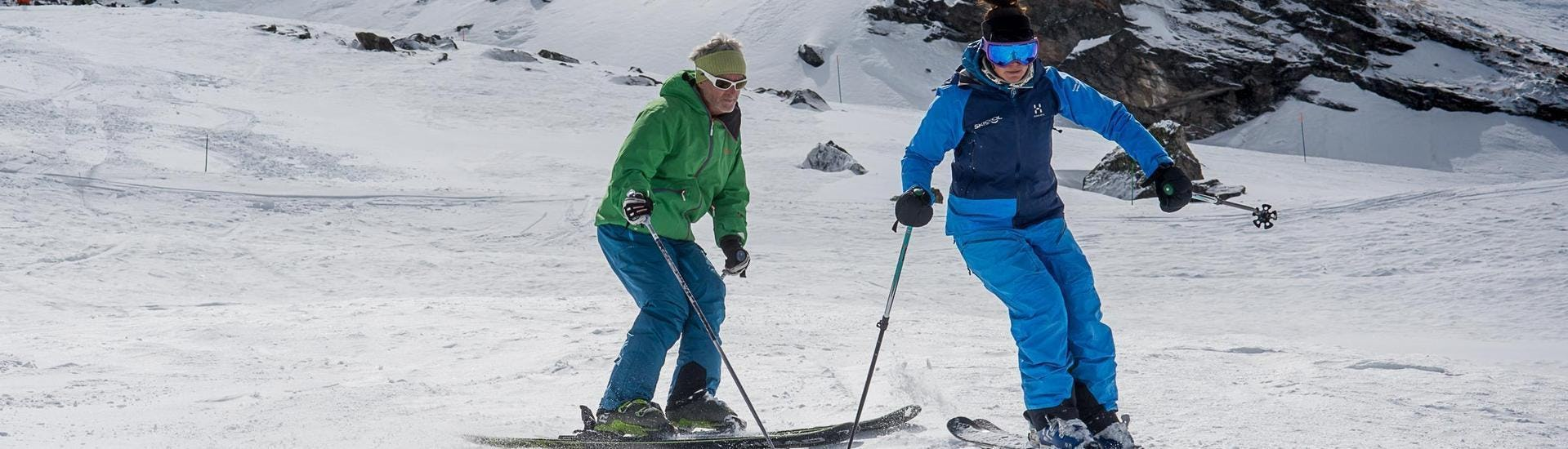 A skier is following his instructor from the ski school Ski Cool down the slope in the ski resort of Val Thorens.