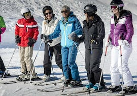 A group of young friends on top of a slope during Ski Lessons for Teens & Adults - Morning - All Levels with the ski school Ski Cool Val Thorens.