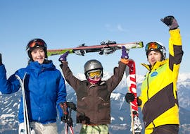 happy kids with ski instructor mountains in the background