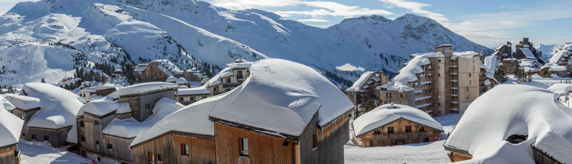 A panoramic view of the snow-covered mountain huts and hotels in the French ski resort of Avoriaz, where local ski schools offer a wide selection of ski lessons.