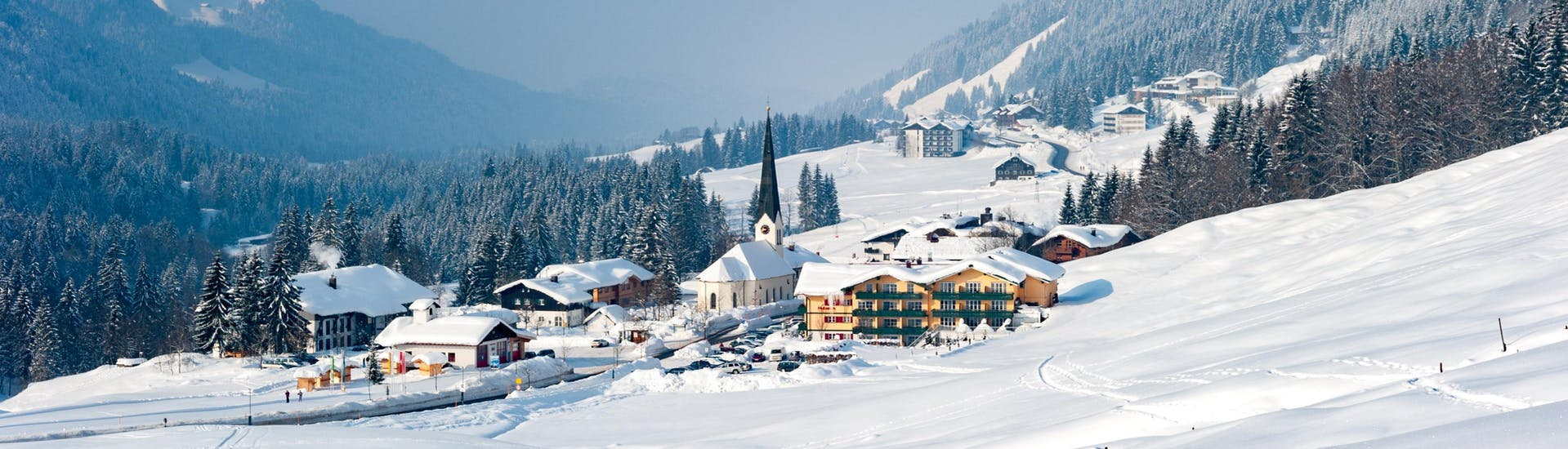 An image of the dreamy little Bavarian village of Baldersachwang in winter, a popular ski resort in which visitors can book ski lessons with one of the local ski schools.