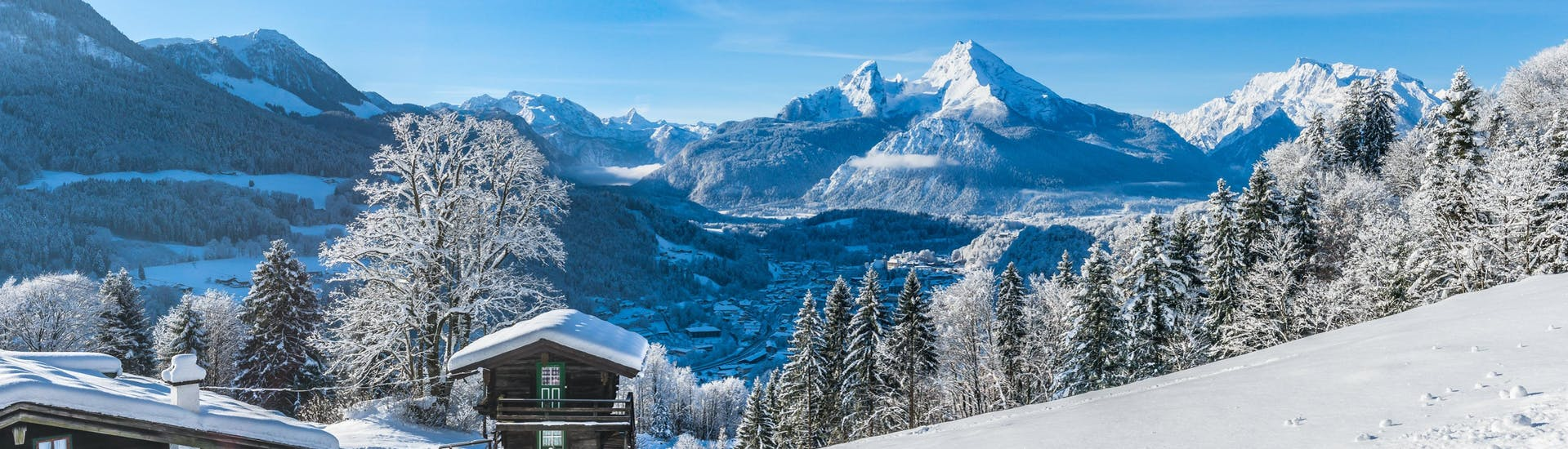 A view of the dreamly winter landscape of Berchtesgadener Land, a popular region in Germany where visitors can books ski lessons with one of the local ski schools.