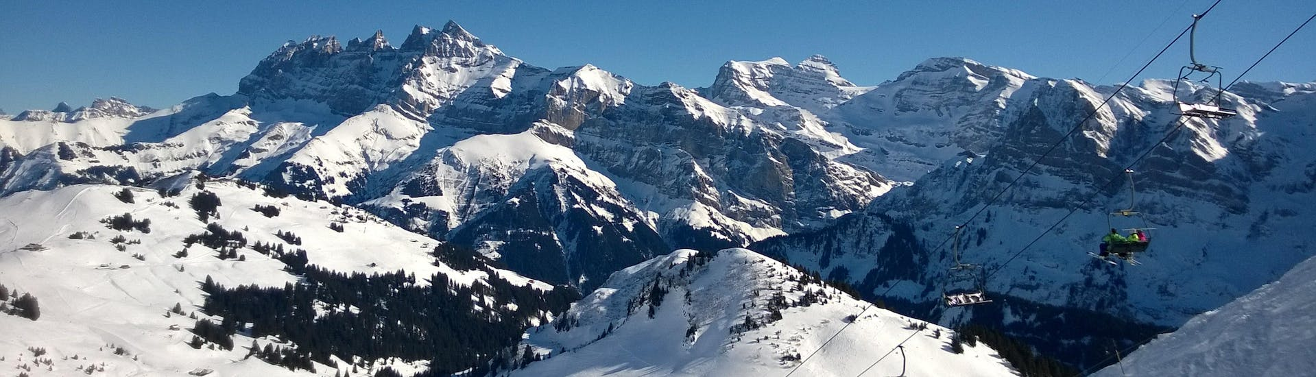 An image of the Dents du Midi close to the Swiss town of Champéry, a popular ski resort where visitors can book ski lessons with one of the local ski schools.