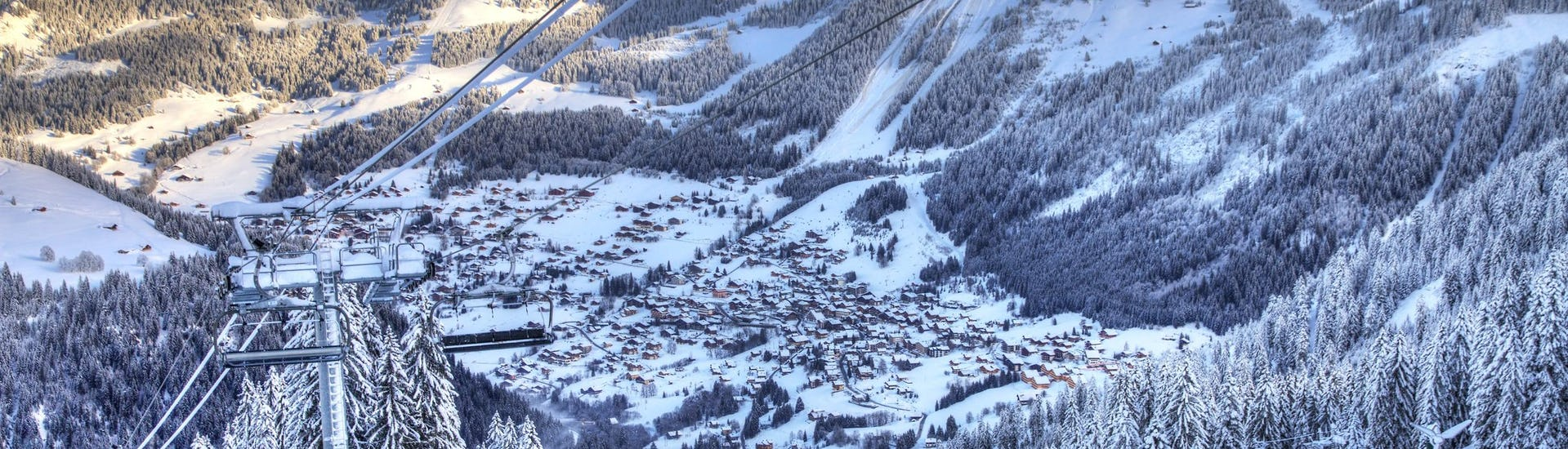 View of the French ski resort of Chatel with its slopes where local ski schools offer a wide range of ski lessons for those who want to learn to ski.