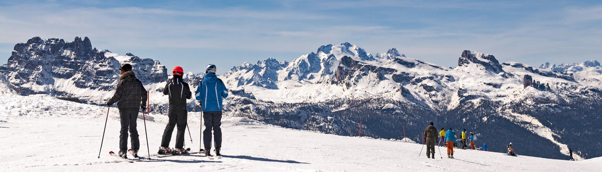 Scenic view of the Dolomites with skiers taking part in ski lessons from ski schools in the ski area Cortina.
