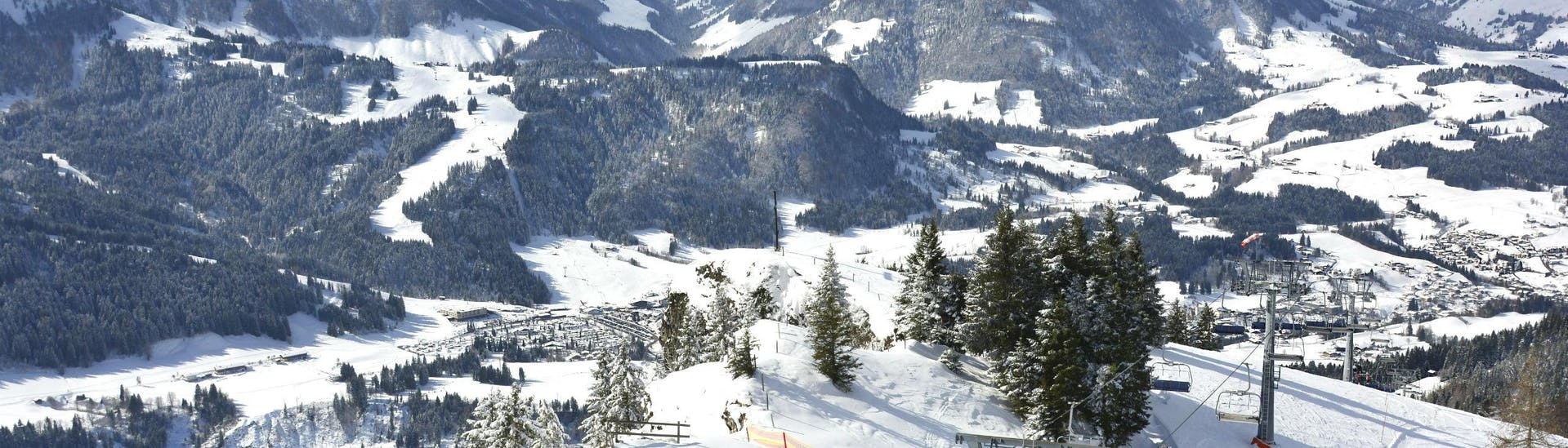 A panoramic view of the Tyrolean ski resort of Fieberbrunn, where a number of ski schools carry out their ski lessons for skiers of all ages and levels.