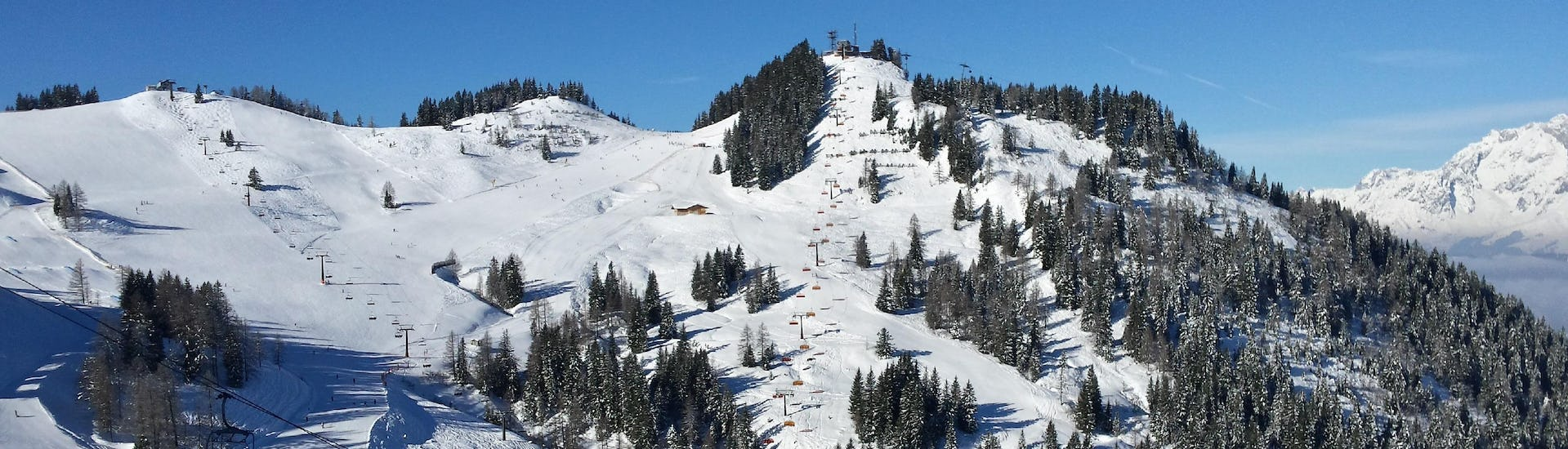 A view of the perfectly groomed ski slopes in the Austrian ski resort of Flachau, where local ski schools offer all types of ski lessons for people who wish to learn to ski.