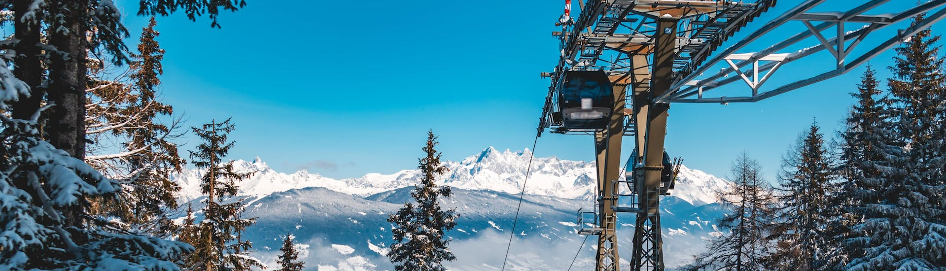 An image of a gondola in the Austrian ski resort of Flachau, where many visitors book ski lessons with one of the local ski schools.