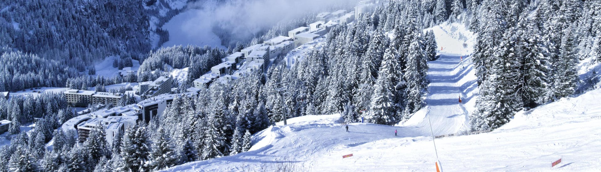 An image of the white winter landscape encountered in the ski resort of Flaine, where local ski schools take their students for their ski lessons.