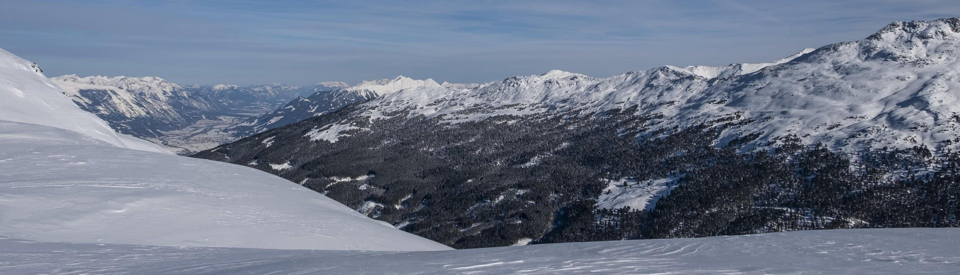 A view of the snow-capped peak of the Glungezer, where local ski schools take aspiring skiers for their ski lessons.