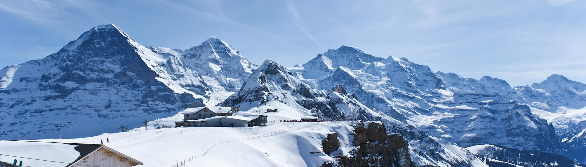 View of the snowy mountain landscape surrounding the mountain station of the cable car in the swiss ski resort of Interlaken.