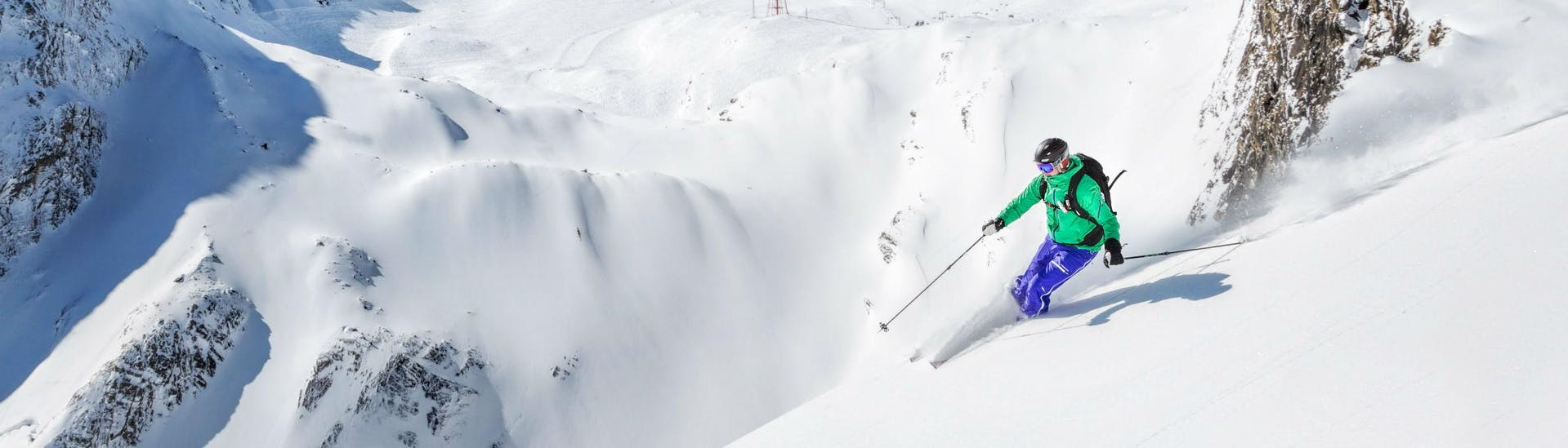 A skier is riding through some fresh powder snow in the Austrian ski resort of Kaprun, where beginners as well as advanced skiers can book ski lessons with the local ski schools.