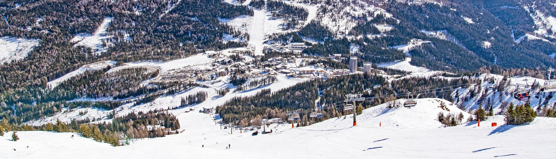 A view of the snow-covered ski slopes in the Austrian ski resort of Katschberg, where skiers can book ski lessons with one of the local ski schools.