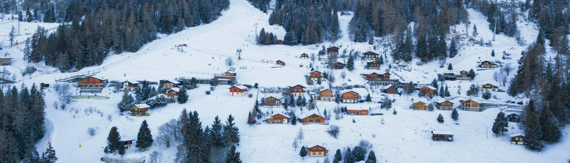 An aereal view of the small village of La Tzoumaz, a popular Swiss ski resort in which visitors can book ski lessons with the local ski schools.