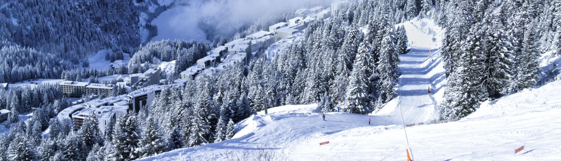 An image of the white winter landscape encountered in the Grand Massif ski region where local ski schools take their students for their ski lessons.